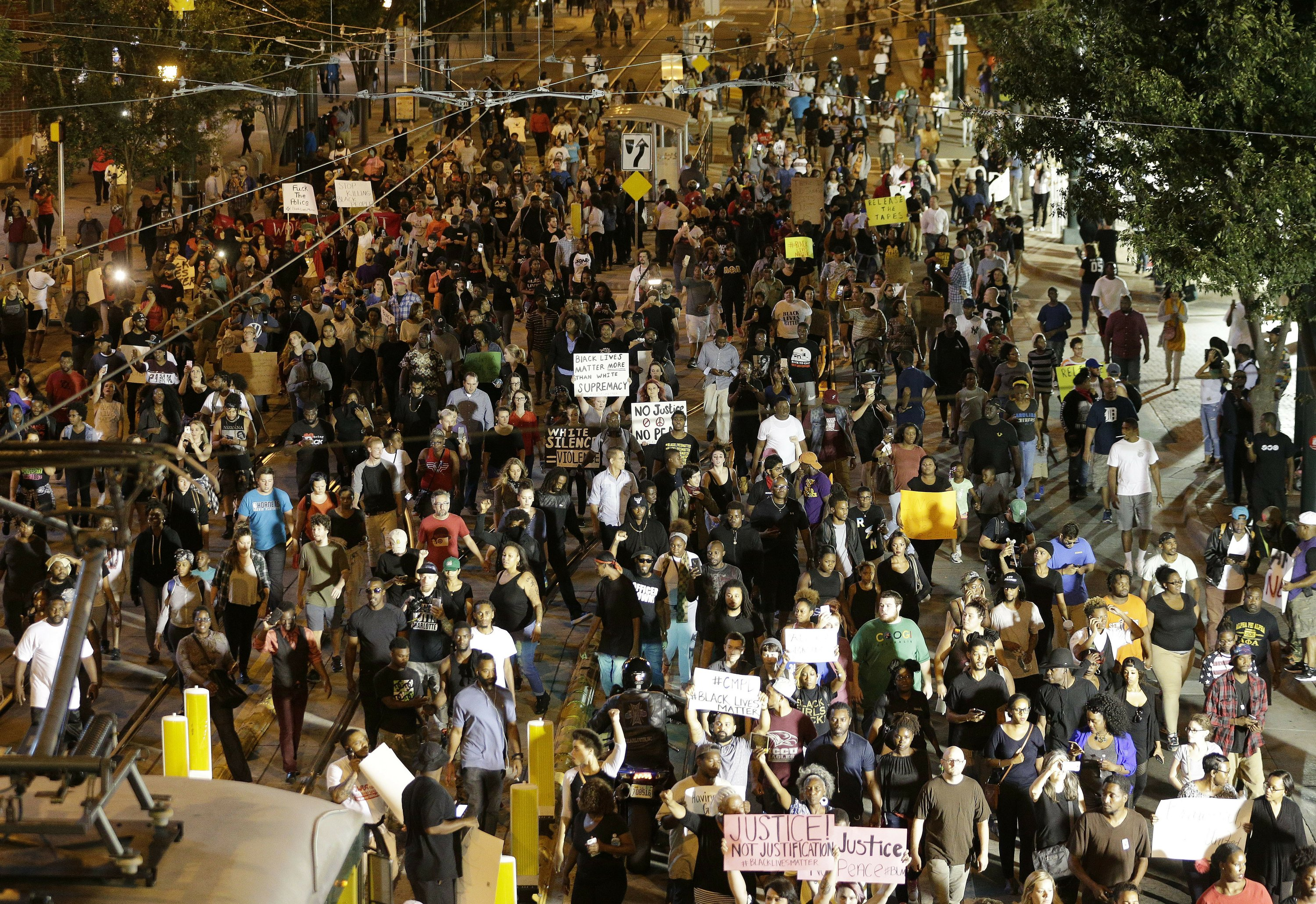 The Latest: Protesters trying to stop cars on interstate