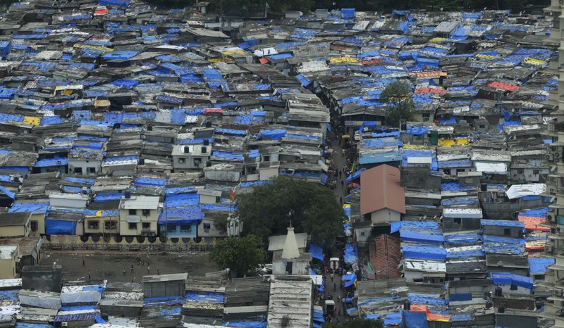 In this Tuesday, June 13, 2017, file photo, roofs of shanties are covered with plastic sheets as protection against monsoon rains in Mumbai, India. India's central bank has cuts its key interest rate by a quarter of a percentage point, raising hopes of lower borrowing costs for households as inflation ebbs. The announcement by the Reserve Bank of India on Wednesday, Aug. 2, reduced its repo rate to 6 percent.