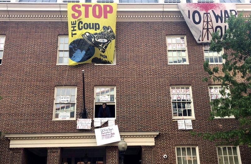 Activists at Venezuelan embassy in US ignore warning
