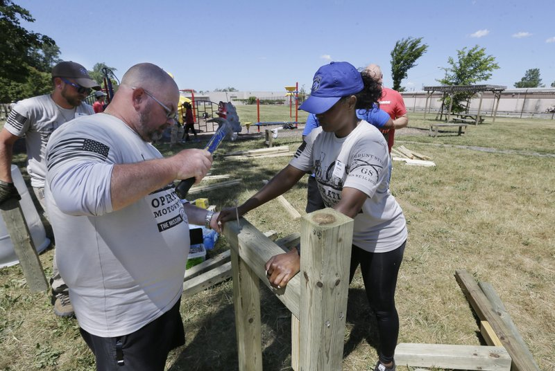 Group deploys military veterans to volunteer in Detroit