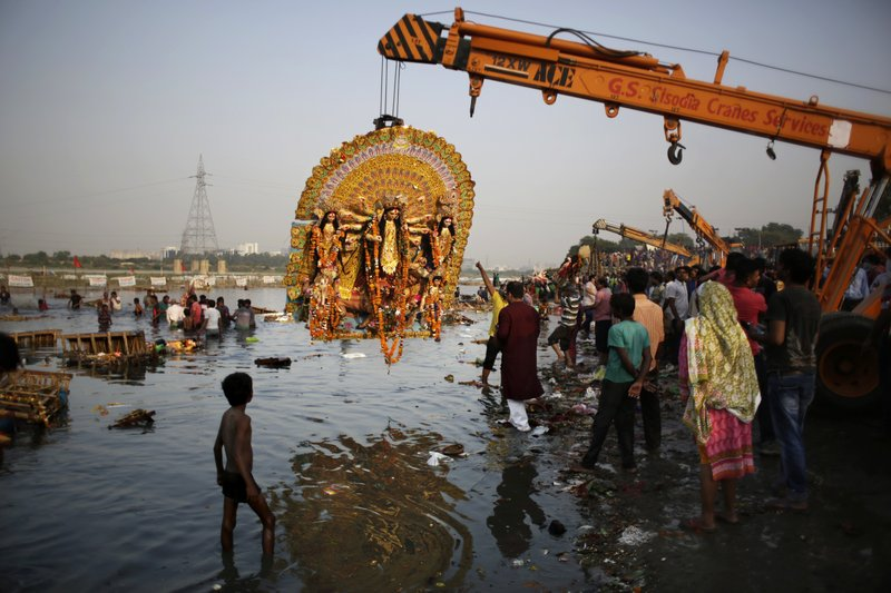 In this Tuesday, Oct. 11, 2016 file photo, a giant Idol of Hindu goddess Durga suspends from a crane before it is immersed in the River Yamuna during Durga Puja festival in New Delhi, India. A court in northern India has granted the same legal rights as a human to the Ganges and Yamuna rivers, considered sacred by nearly a billion Indians. The Uttaranchal High Court in Uttarakhand state ruled Monday, March 20, 2017, that the two rivers be accorded the status of living human entities, meaning that if anyone harms or pollutes the rivers, the law would view it as no different from harming a person.
