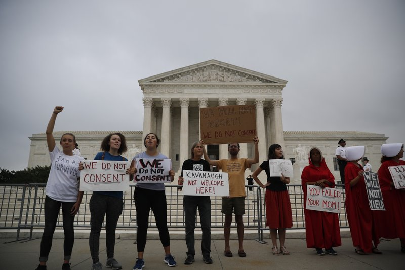 The Latest: Kavanaugh asks questions in first day on bench
