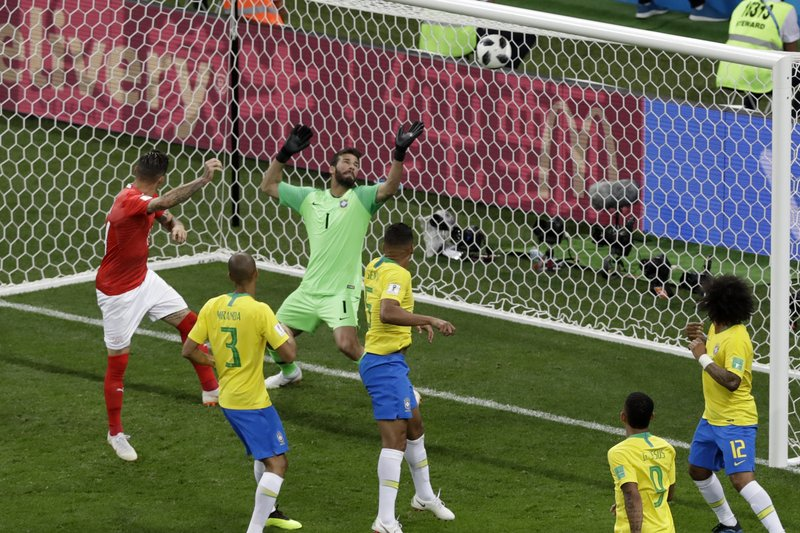 Switzerland's Steven Zuber, left, scores his side's first goal during the group E match between Brazil and Switzerland at the 2018 soccer World Cup in the Rostov Arena in Rostov-on-Don, Russia, Sunday, June 17, 2018.