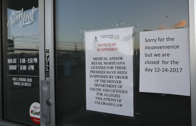 Closed signs on Sweet Leaf marijuana dispensary on S. Federal Blvd in denver