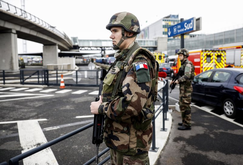 The Latest: Orly attacker used revolver to detain soldier