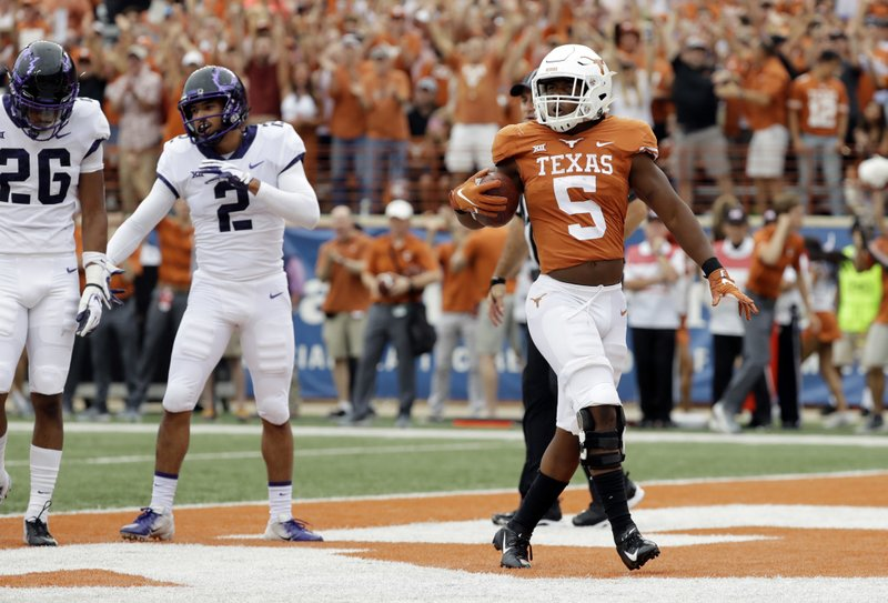 classic fit a7c1c 6f1f9 Texas ends 4-year skid against No. 17 TCU 31-16