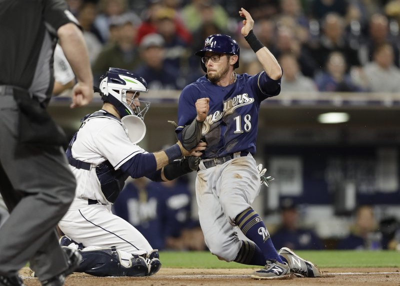 Milwaukee Brewers' Eric Sogard is tagged out by San Diego Padres catcher Austin Hedges trying to score from third base during the fourth inning of a baseball game, Tuesday, May 16, 2017, in San Diego. (AP Photo/Gregory Bull)