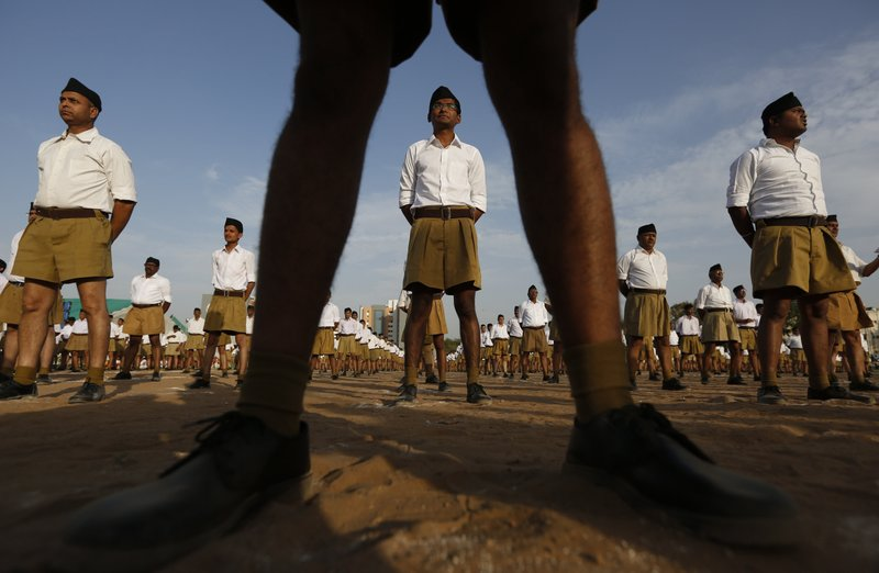In this April 10, 2016, file photo, members of Hindu nationalist Rashtriya Swayamsevak Sangh (RSS), or National Volunteer Organization, stand during Varsh Pratipada festival, the Hindu New Year in Ahmadabad, India. A series of incidents this fall have reinforced fears that anti-Muslim sentiment has hardened in India in the three years since a right-wing Hindu nationalist party led by Prime Minister Narendra Modi swept to power.
