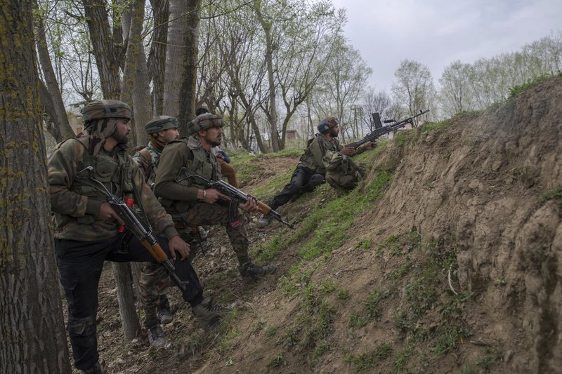 Indian army soldiers take position near the site of a gun battle in Chadoora town, about 25 kilometers (15 miles) south of Srinagar, Indian controlled Kashmir, Tuesday, March 28, 2017. The gunbattle began after police and soldiers cordoned off the southern town of Chadoora following a tip that at least one militant was hiding in a house, said Inspector-General Syed Javaid Mujtaba Gillani. As the fighting raged, hundreds of residents chanting anti-India slogans marched near the area in an attempt to help the trapped rebel escape.