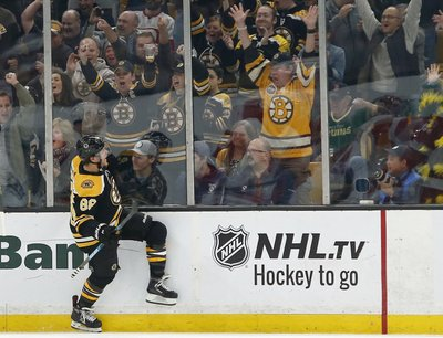 2edbb4846d3ade BOSTON (AP) — David Pastrnak scored three times, giving him 101 goals in  his career, and Patrice Bergeron had three assists as the Boston Bruins  kept ...