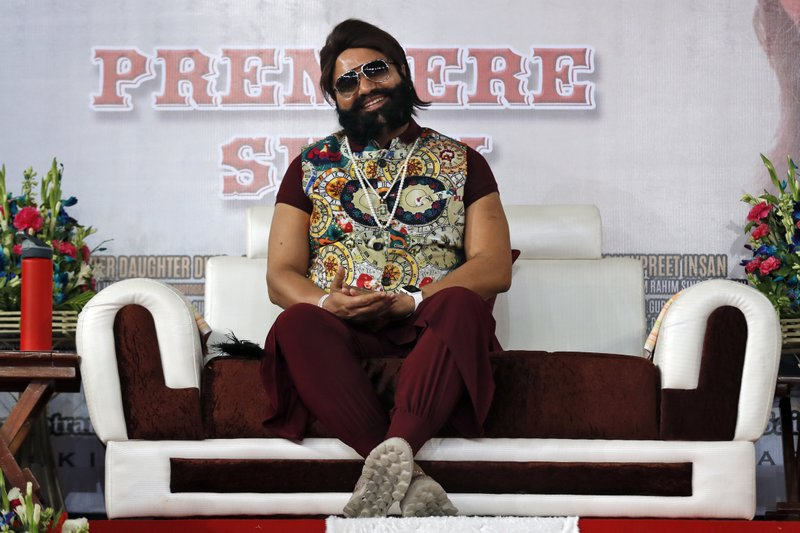 In this May 17, 2017 file photo, an Indian spiritual guru, who calls himself Saint Dr. Gurmeet Ram Rahim Singh Ji Insan, attends the premiere of the movie 'Jattu Engineer' in New Delhi, India. A north Indian court on Friday, Aug. 25, convicted the flamboyant leader of a quasi-religious sect of raping two of his followers, prompting thousands of supporters camped out near the courthouse to shout angry protests.