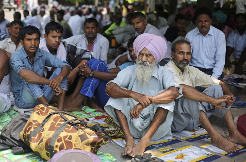 Supporters of the Dera Sacha Sauda sect squat in a public park near an Indian court in Panchkula, India, Thursday, Aug. 24, 2017. Several north Indian cities were under a security lock down Thursday, a day before a court was expected to issue a verdict in a rape case involving a man who calls himself Saint Dr. Gurmeet Ram Rahim Singh Ji Insan, the flamboyant leader of a quasi-religious sect.