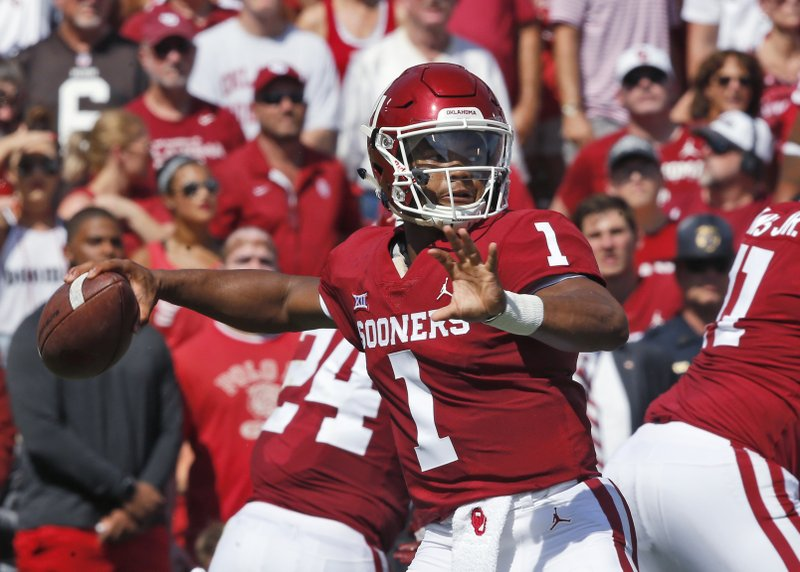 Murray leads No  7 Oklahoma past Florida Atlantic 63-14