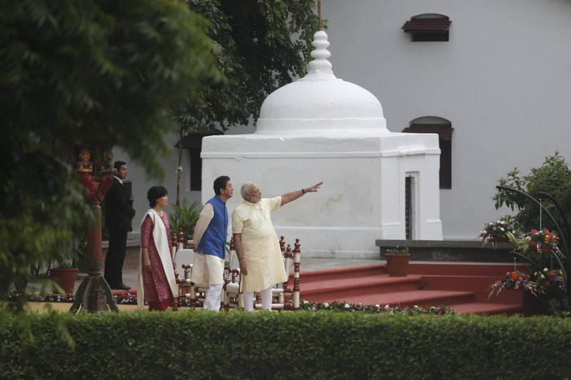 Indian Prime Minister Narendra Modi gestures as he speaks with Japanese Prime Minister Shinzo Abe and his wife Akie Abe at Sabarmati Ashram, or Gandhi Ashram, in Ahmadabad, India, Wednesday, Sept. 13, 2017. Abe is on a two-day official visit to India.
