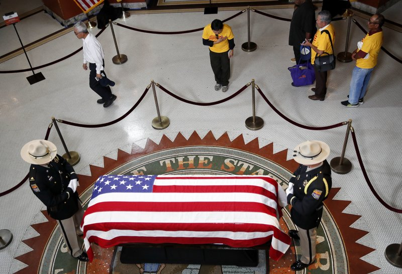 Family, friends mourn McCain as memorial services begin