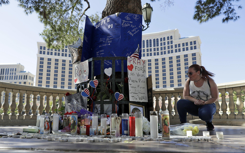 The Latest: Gun shop owner recalls visit by Vegas shooter