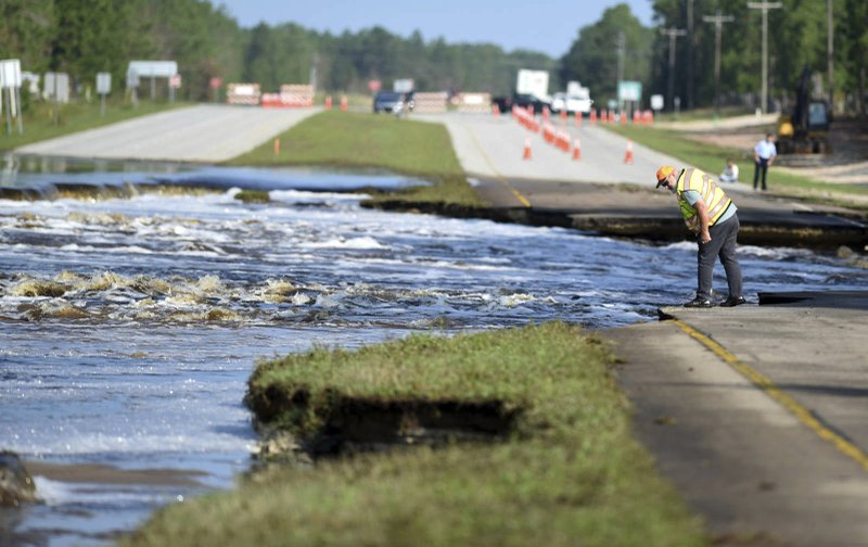 Flooding From Sutton Lake Has Washed Away Part Of U.S. 421 In New Hanover  County Just South Of The Pender County Line In Wilmington, N.C., Friday,  Sept.