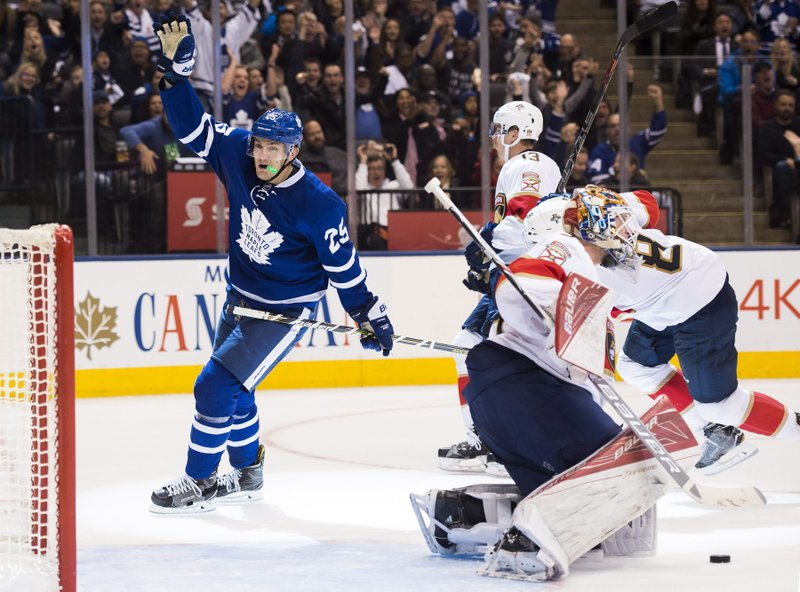 946e6751f Toronto Maple Leafs left wing James van Riemsdyk (25) reacts after scoring  against Florida Panthers goalie James Reimer (34) during second-period NHL  hockey ...