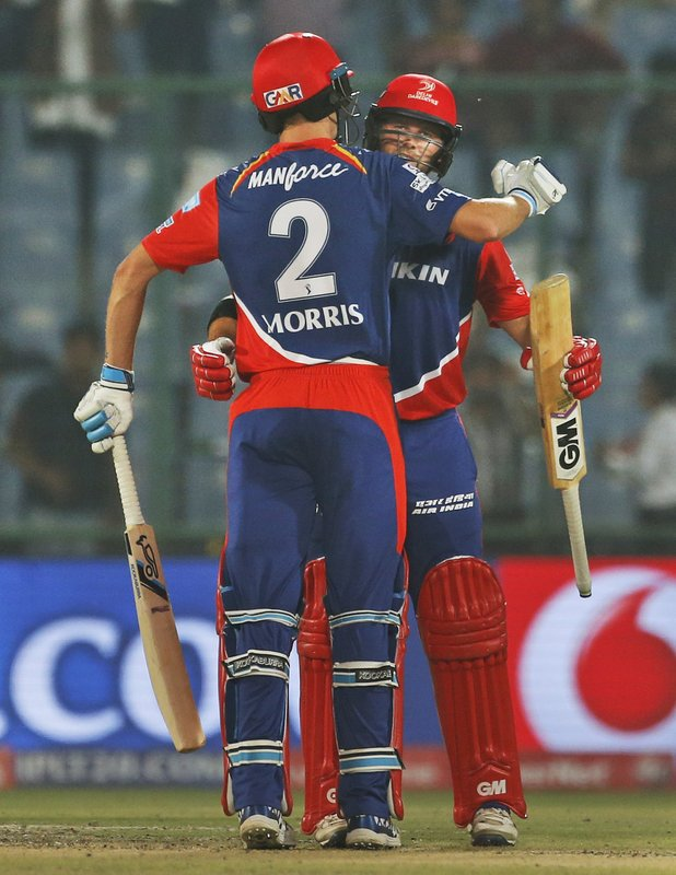 Delhi Daredevils' batsman Corey Anderson, rear, and his teammate Chris Morris embrace each other after winning their Indian Premier League (IPL) cricket match against Sunrisers Hyderabad in New Delhi, India, Tuesday, May 2, 2017.
