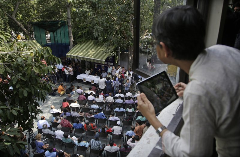 An unidentified journalist takes photographs with her iPad of a protest meeting against the killing of Indian journalist Gauri Lankesh by journalists and members of civil society at Press Club of India in New Delhi, India, Wednesday, Sept. 6, 207. Even as police promise to hunt down the assailants who gunned down Lankesh outside her Bangalore home Tuesday night, many said they feared the perpetrators of this attack, like so many others, would get away with impunity.