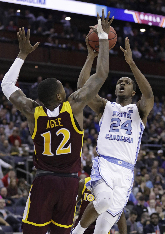 NCAA Latest: Midwest No. 1 Tar Heels rally past 16-seed Iona