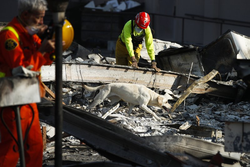 Members Of A Search And Rescue Team Dog Through The Rubble Mobile Homes Destroyed By Wildfire Monday Oct 16 2017 In Santa Rosa Calif