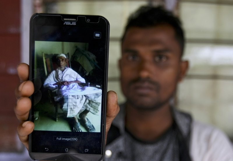 In this Tuesday, Sept. 12, 2017, photo, Rohingya refugee Muhammad Ayub shows off a picture of his grandfather allegedly killed during recent violence in Myanmar, in Klang on the outskirts of Kuala Lumpur, Malaysia. Recent violence in Myanmar has driven hundreds of thousands of Rohingya Muslims to seek refuge across the border in Bangladesh. There are some 56,000 Rohingya refugees registered with the U.N. refugee agency in Malaysia, with an estimated 40,000 more whose status has yet to be assessed.
