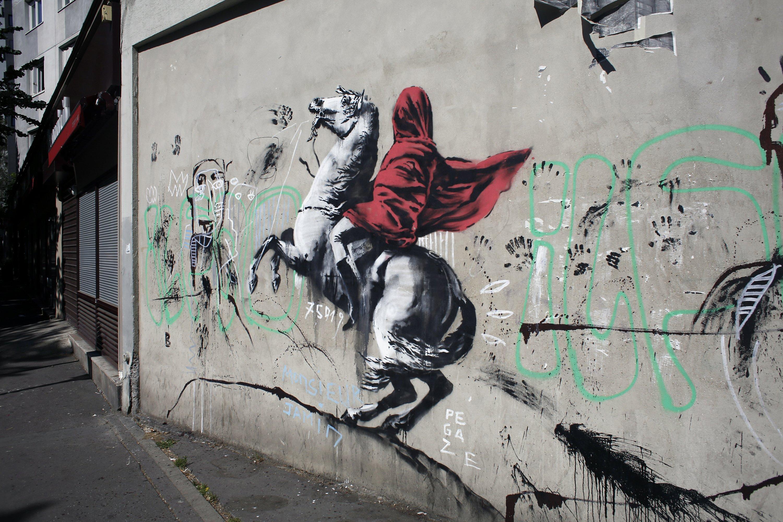 Street artist Banksy splashes Paris with works on migrants