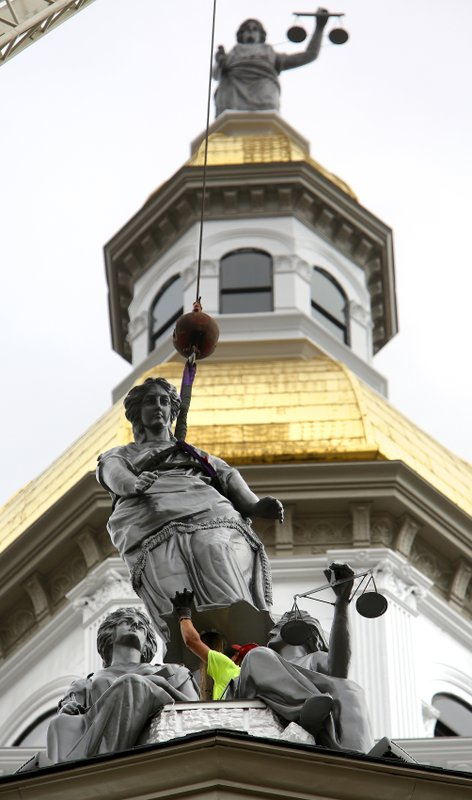 Statues returned to perches at Dubuque County Courthouse