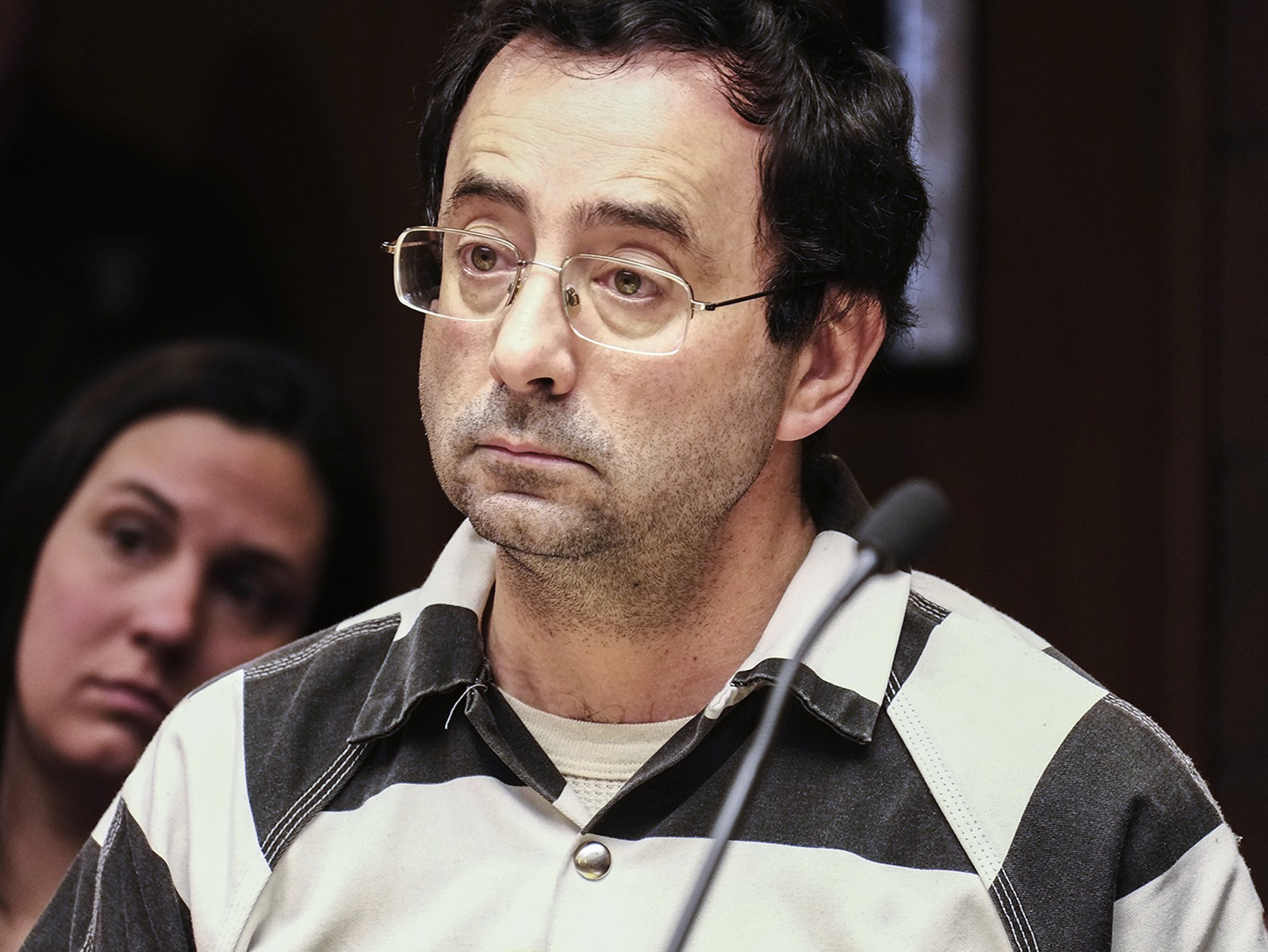 Michigan sports doctor to stand trial in sexual assault case