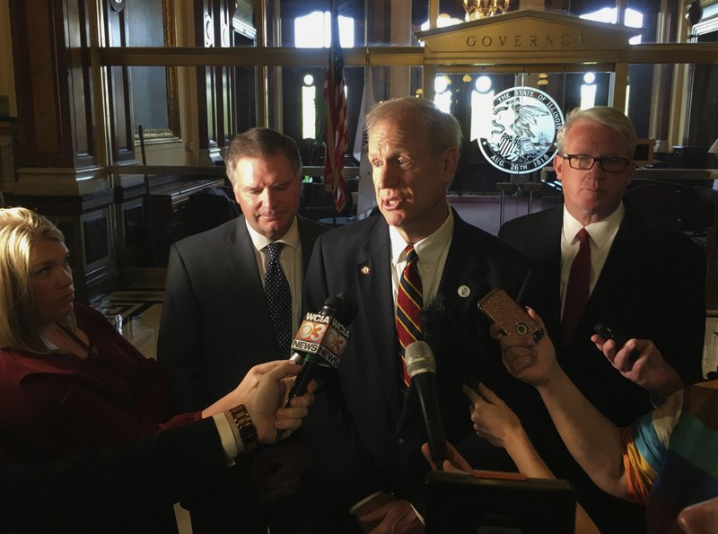 Illinois governor who loudly demanded reforms now is silent file in this may 8 2018 file photo illinois gov bruce rauner center addresses reporters outside his state capitol office in springfield malvernweather Gallery