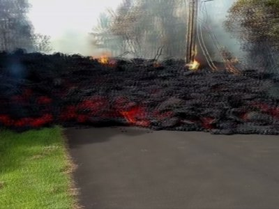 Lava Flow Oozes onto Hawaii Pavement