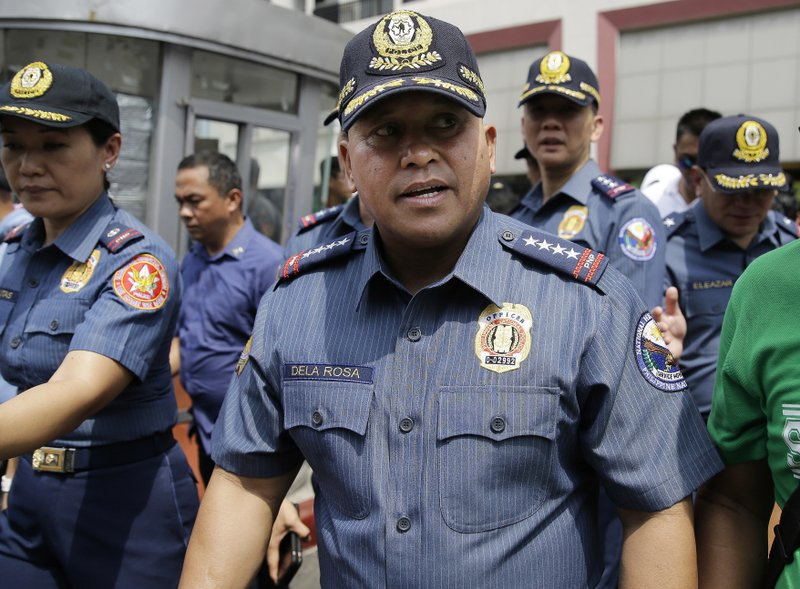 Philippine National Police Chief Ronald dela Rosa walks after an anti-terror simulation exercise at a bus terminal in Quezon city, north of Manila, Philippines on Tuesday, April 11, 2017. Dela Rosa said at least several people have been killed in battle between government forces and suspected Abu Sayyaf militants on a central resort island, far from the extremists' southern jungle bases and in a region where the U.S. government has warned the gunmen may be conducting kidnappings.