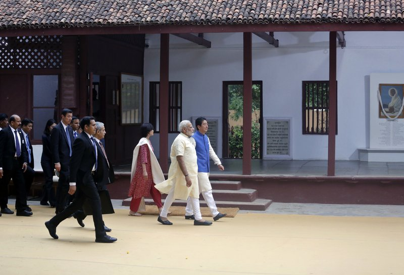 Japanese Prime Minister Shinzo Abe, his wife Akie Abe, and Indian Prime Minister Narendra Modi visit Sabarmati Ashram, or Gandhi Ashram, in Ahmadabad, India, Wednesday, Sept. 13, 2017. Abe is on a two-day official visit to India.