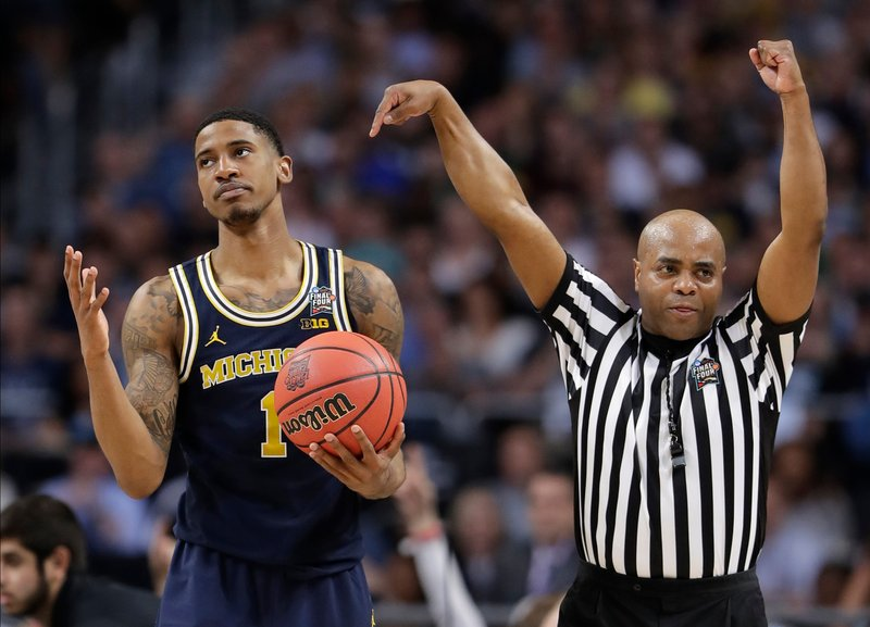 12d42d11109 Michigan's Charles Matthews (1) reacts to a foul call during the second  half in the championship game of the Final Four NCAA college basketball  tournament ...