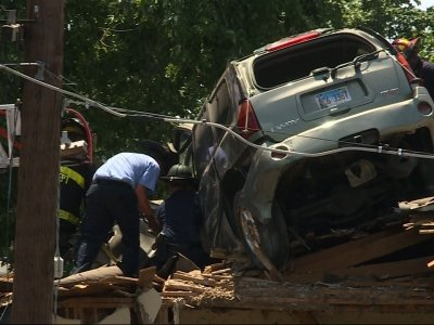 SUV Driver Crashes into Roof of St. Louis Home