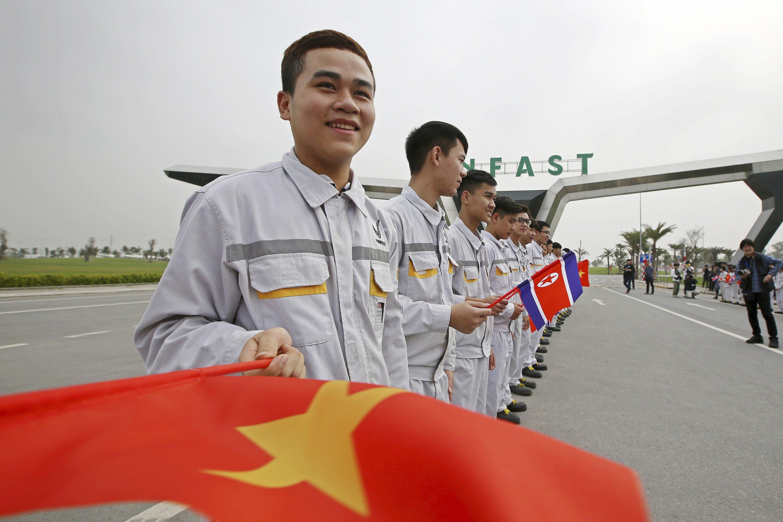 On summit sidelines, North Koreans study Vietnam's economy