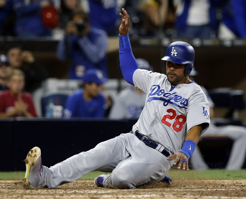 Los Angeles Dodgers' Franklin Gutierrez slides into home without a throw, scoring on a two-run double by Andrew Toles during the seventh inning of a baseball game against the San Diego Padres in San Diego, Friday, May 5, 2017. (AP Photo/Alex Gallardo)