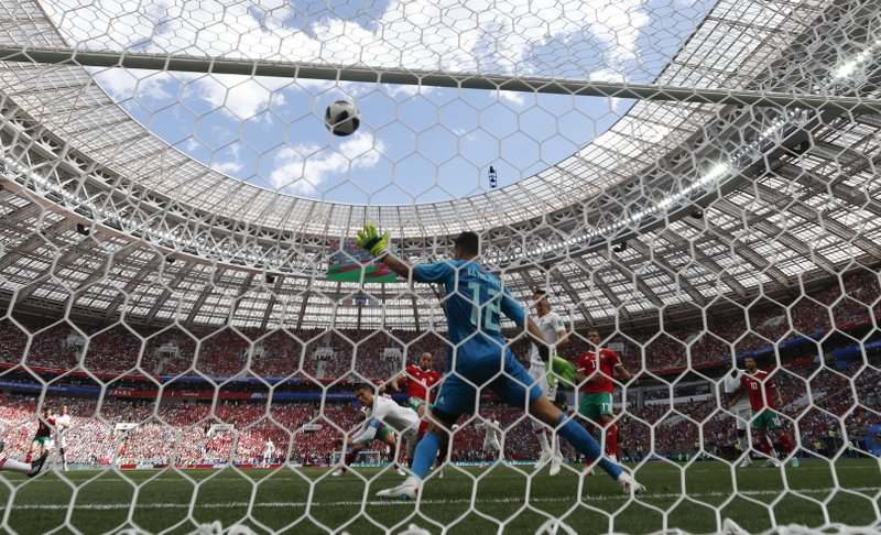 Portugal's Cristiano Ronaldo scores his side's opening goal during the group B match between Portugal and Morocco at the 2018 soccer World Cup in the Luzhniki Stadium in Moscow, Russia, Wednesday, June 20, 2018.