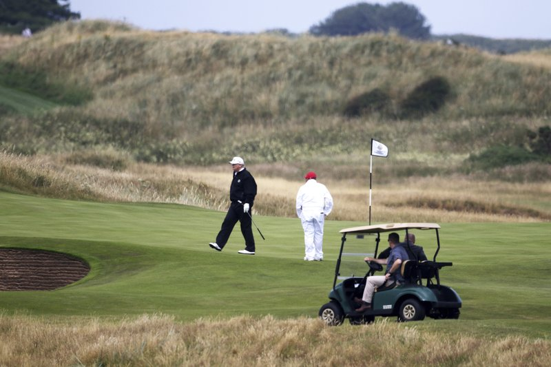 150b617b3ac6 ... July 14, 2018, file photo, U.S. President Donald Trump walks off the  4th green while playing at Turnberry golf club, in Turnberry, Scotland.