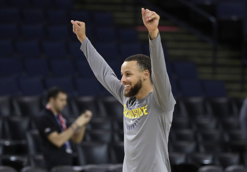 94273cf25 Golden State Warriors  Stephen Curry gestures to a teammate during an NBA  basketball practice