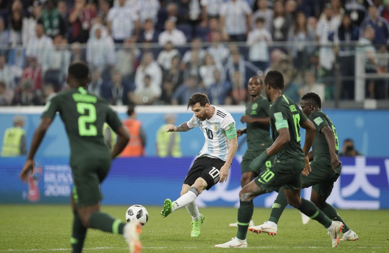 Argentina's Lionel Messi, center, kicks the ball during the group D match between Argentina and Nigeria at the 2018 soccer World Cup in the St. Petersburg Stadium in St. Petersburg, Russia, Tuesday, June 26, 2018.