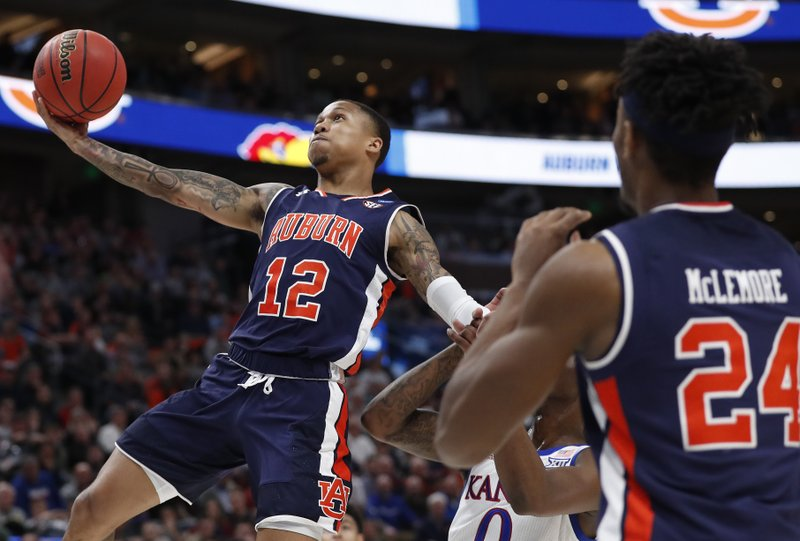 Ncaa Latest Auburn Trounces Kansas To Reach Sweet 16