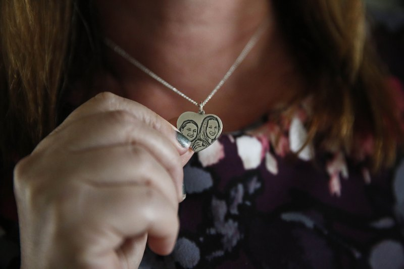 Lori Alhadeff holds a necklace of her and her daughter on Wednesday, Jan. 30, 2019, in Parkland, Florida. (AP Photo/Brynn Anderson)