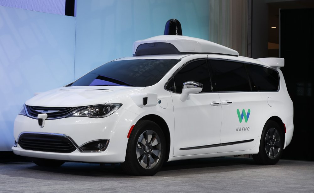 FILE - In this Jan. 8, 2017, file photo a Chrysler Pacifica hybrid outfitted with Waymo's suite of sensors and radar is displayed at the North American International Auto Show in Detroit. (AP Photo/Paul Sancya, File)