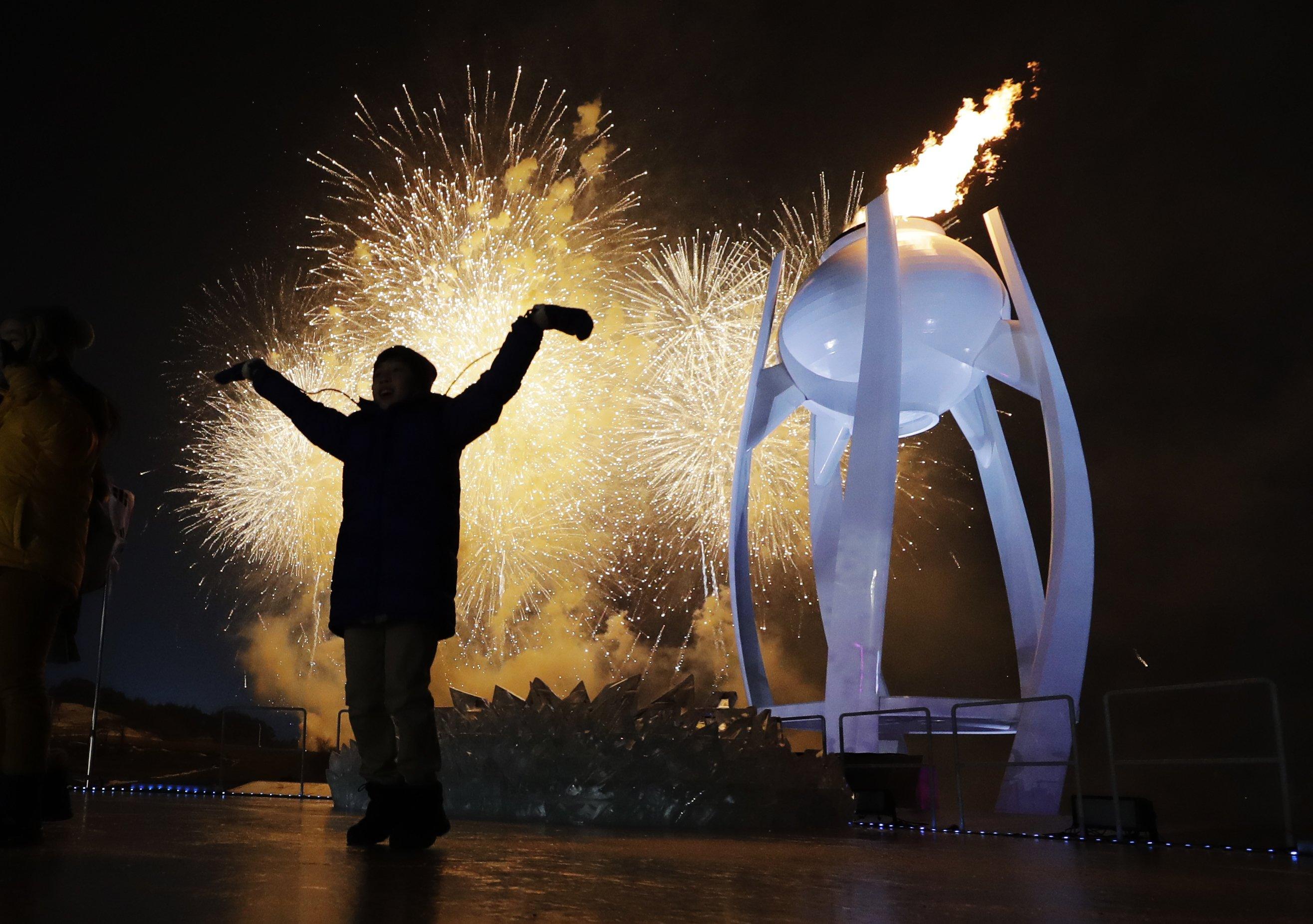 At Olympics, fiery optics both entertaining and symbolic