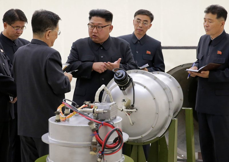 This undated file image distributed on Sunday, Sept. 3, 2017, by the North Korean government, shows North Korean leader Kim Jong Un at an undisclosed location. North Korea's latest nuclear test was part theater, part propaganda and maybe even part fake. But experts say it was also a major display of something very real: Pyongyang's mastery of much of the know-how it needs to reach its decades-old goal of becoming a full-fledged nuclear state. The jury is still out on whether North Korea tested, as it claims, a hydrogen bomb ready to be mounted on an ICBM.