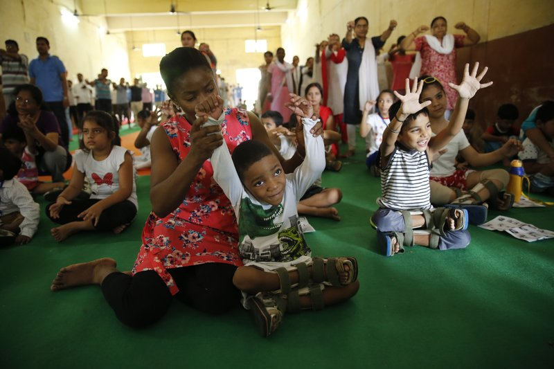 Children with cerebral palsy perform yoga on International Day of Yoga in Allahabad, India, Thursday, June 21, 2018. Yoga enthusiasts across the world Thursday took part in mass yoga events to mark International Yoga Day.