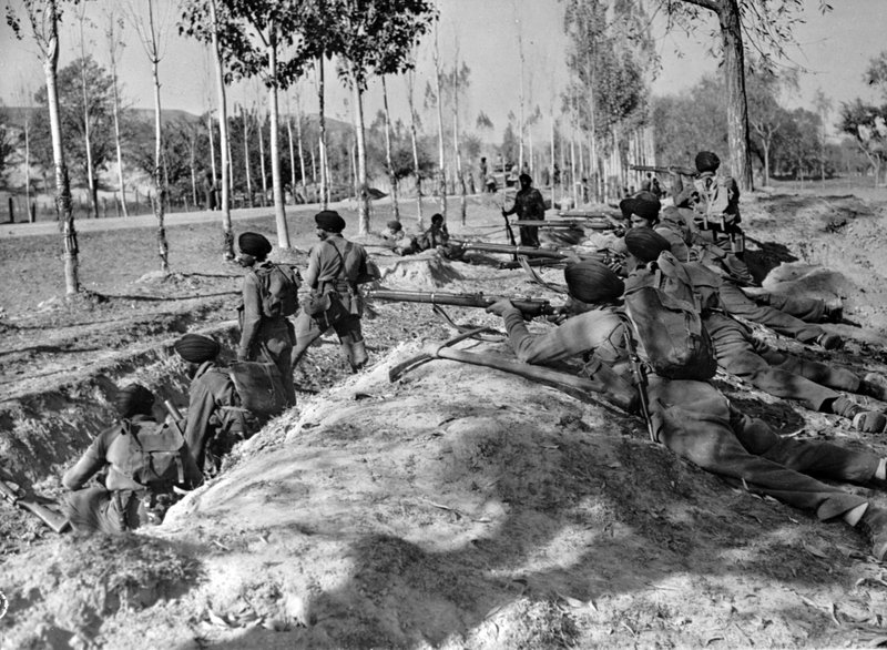 In this Nov. 9, 1947 file photo, Indian Sikh troops take up roadside positions on the Baramula Road to help force invaders further away from the Kashmir capital, Srinagar. A raid by armed tribesmen from north-western Pakistan forced Maharaja Hari Singh of the Himalayan kingdom of Jammu and Kashmir to seek help from India, which offered military assistance on the condition that the kingdom accede to India. The ruler accepted but insisted that the region would remain a largely autonomous state within the Indian union, with India managing its foreign affairs, defense, and telecommunication. The Indian military entered the region soon after, and the tribal raid spiraled into the first of two wars between India and Pakistan over Kashmir. The war ended in 1948 with a United Nations brokered ceasefire.As the 70th anniversary of India-Pakistan Partition comes up next week, relations between the two nations are as broken as ever. In some ways, their violent birth pangs dictated their future course through suspicion and animosity.