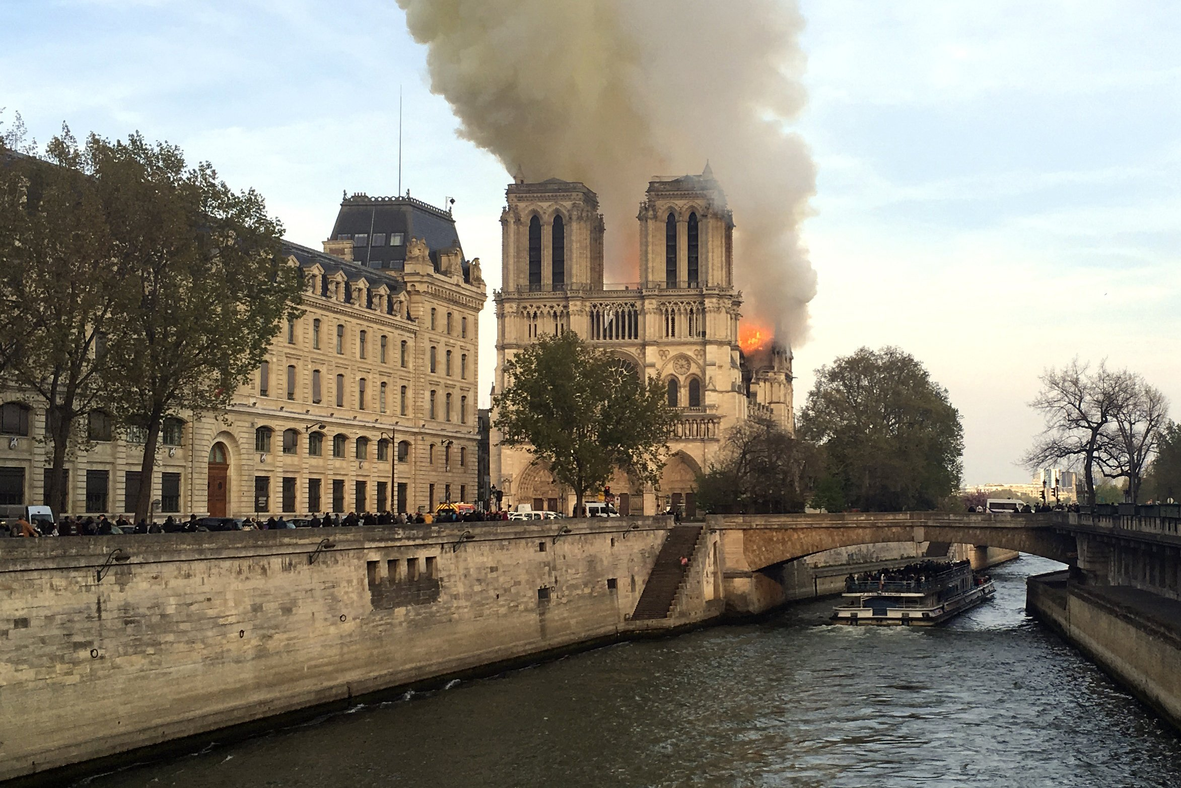 The Latest: Notre Dame spire collapses, interior in flames
